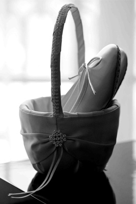 Black and white photo of ballet slippers in basket