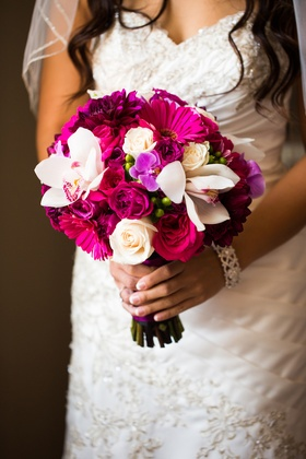 Vibrant pink and fuchsia wedding bouquet with orchid, rose, gerber daisy