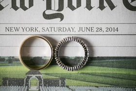 Gold men's band and platinum eternity band on New York Times