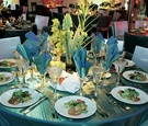 Shiny blue linens on reception tables
