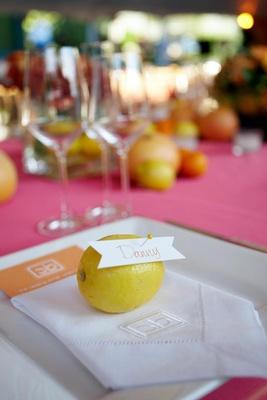 Seating card pinned to fresh lemon on plate