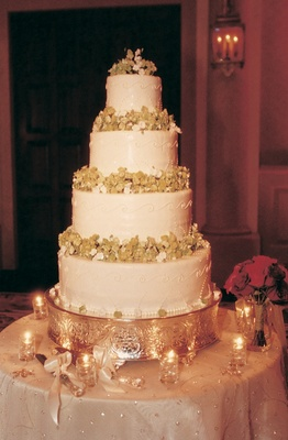 white wedding cake with four tiers