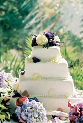 Four tier white cake with beading detail