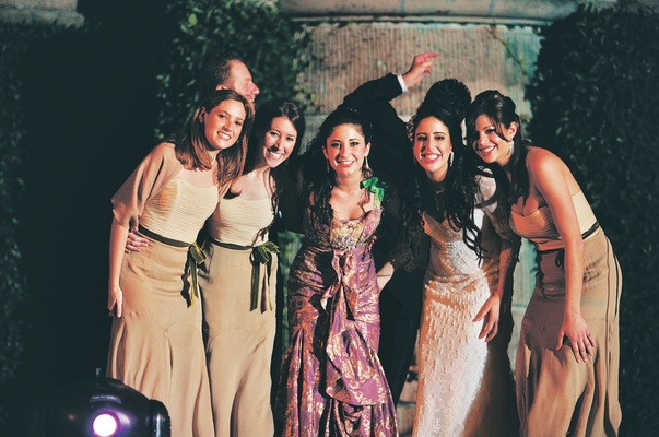 Bridesmaids in Liancarlo champagne dresses with green sashes