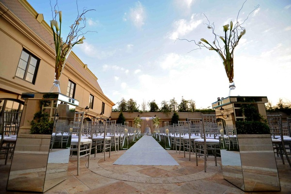 Silver chairs and aisle at outdoor ceremony