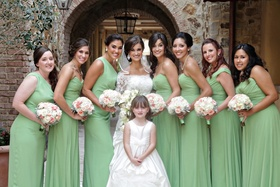 Bride and flower girl with bridesmaids at Tuscan-style venue