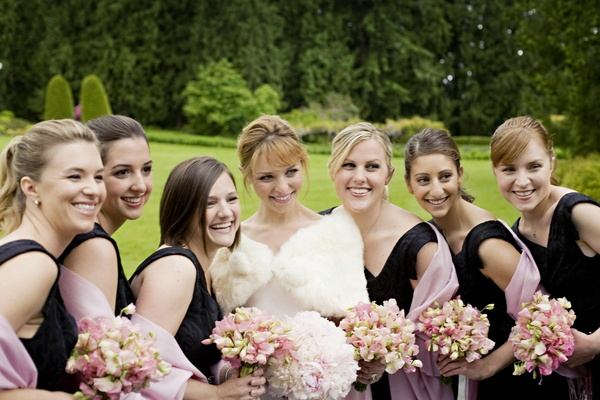 bridesmaids and bride hold bouquets