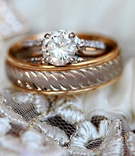 Round-cut engagement ring and gold band