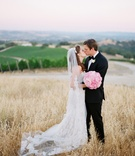 Bride and groom kissing at family vineyard
