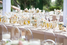 Long rectangular table surrounded by Ghost chairs