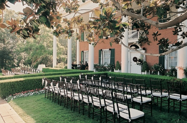 rows of chairs on lawn of grand estate