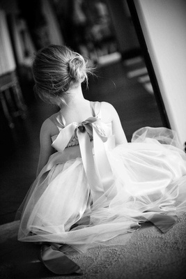 Black and white photo of back of flower girl dress