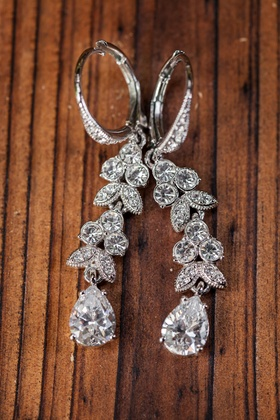 Marquise-set diamonds and teardrop shaped earring