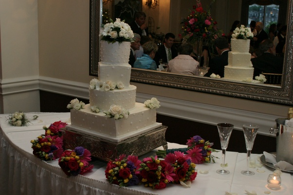 Four layer cake with bridesmaid bouquets