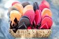 Red, orange, and dark grey flip-flops offered at at wedding