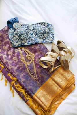 Bride's purple and gold wedding ceremony sari and the beaded blue top of her reception outfit
