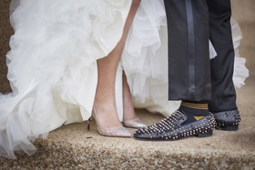 Groom's black shoes covered in gold, silver, and black studs