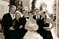 newlyweds pose with family members