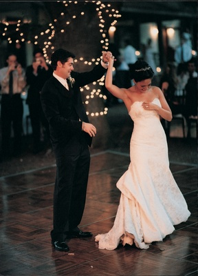 Newlyweds' first dance at outdoor reception