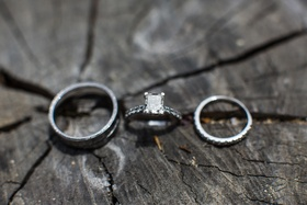 silver wedding band, engagement ring and diamond wedding band
