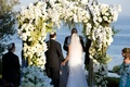 Bride and groom married under chuppah