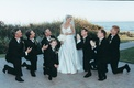 groomsmen look up at bride in funny photo