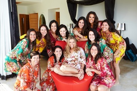 Bridesmaids and bride in flower print short robes in bridal suite