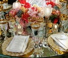 Pearl and gilt charger plates and vibrant florals