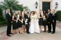 Lesbian couple with bridesmaids and best man