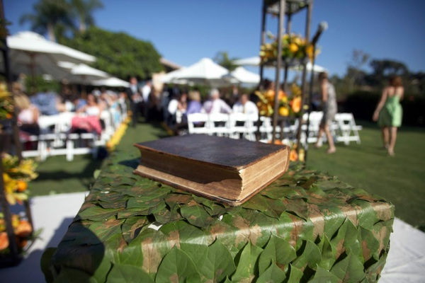 Holy Bible on table at altar with green leaf decorations