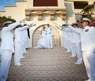 Navy men in dress whites on tile steps