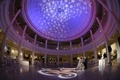 Star design on ceiling and purple lighting reception
