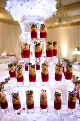 Wedding appetizers in shot glasses on ice pyramid