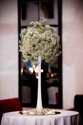 Fluted vase filled with baby's breath blossoms