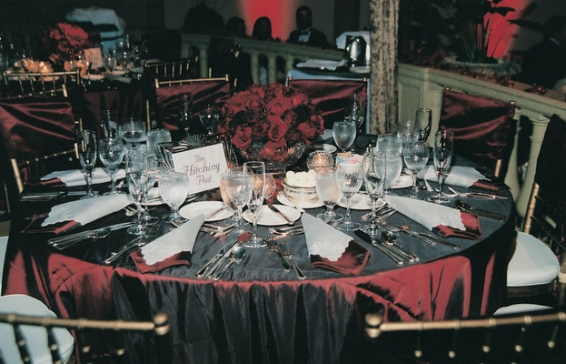Cranberry toned tablecloths and centerpieces