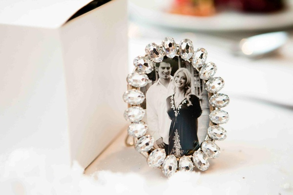 Black and white photo of couple in jeweled frames