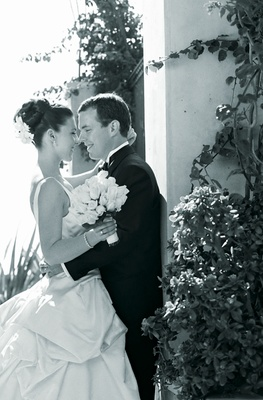black and white bride and groom hug at wedding