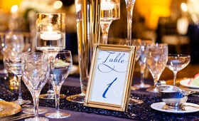 White and navy blue stationery with gold frame for wedding table