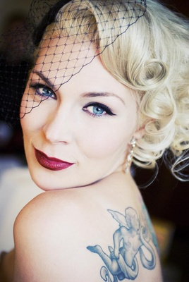 Bride in a black wedged veil and vintage look makeup