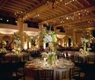 White and light pink flower arrangements at wedding reception