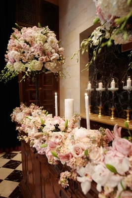 Floral and candlelit church decorations