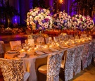 Oval table surrounded by ruffled chair covers