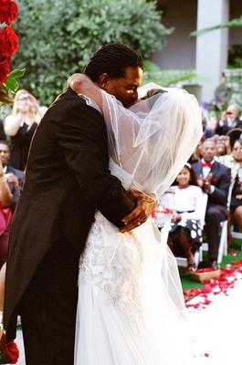 Sherry Jackson Gordy and groom kissing