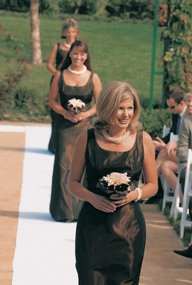 Bridesmaids walk down aisle