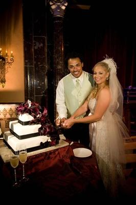 Nicholas Barnett and wife cut alternative wedding cake