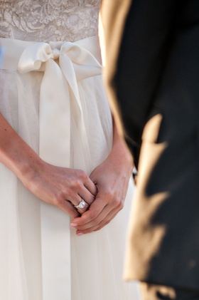 Bride in Monique Lhuillier dress with diamond engagement ring