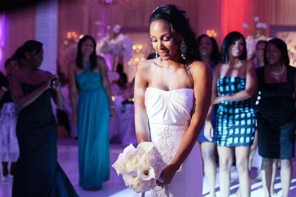 Alexandria Lopez tossing white flowers to single women