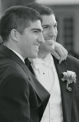 Black and white photo of groom and groomsman
