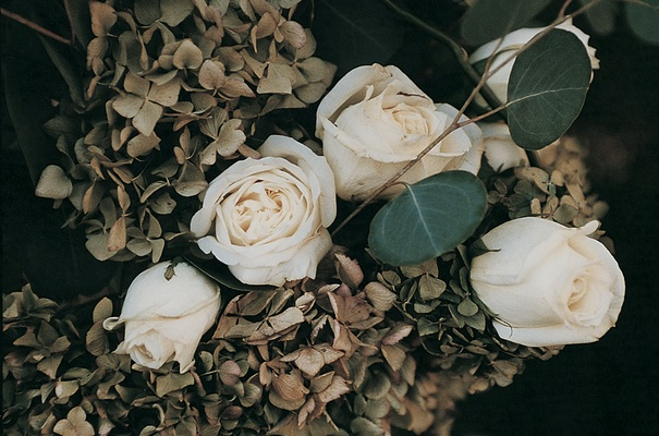 Fall-hued hydrangeas, white roses, and eucalyptus