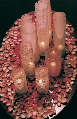 Table covered with pink petals and candles